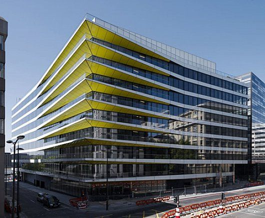 Yellow building pointed and reflective by David Walker  REN D