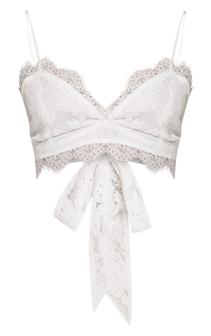 7bab047af14a57 Kacy White Lace Cross Strap Bralet ( 29) ❤ liked on Polyvore featuring tops