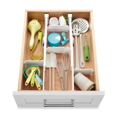 Organize cooking & serving utensils with expandable drawer dividers like these from Real Simple