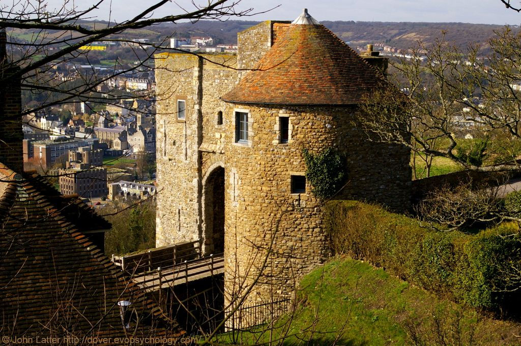 Rare view of Peverell Gateway, Western Outer Curtain Wall, Dover Castle, Kent, England, UK. Built by King John and Henry III on Knight's Road. Also called Peverell's Gate, Peverell's Tower; and Marshal's, Beauchamp's, and Bell Tower. Drawbridge to south (in view). Georgian Sergeant Major's House bottom-left. Listed Building, English Heritage Holiday Cottage, and Scheduled Ancient Monument. Architecture, Norman Medieval History. Travel and Tourism. See: http://www.panoramio.com/photo/49045522