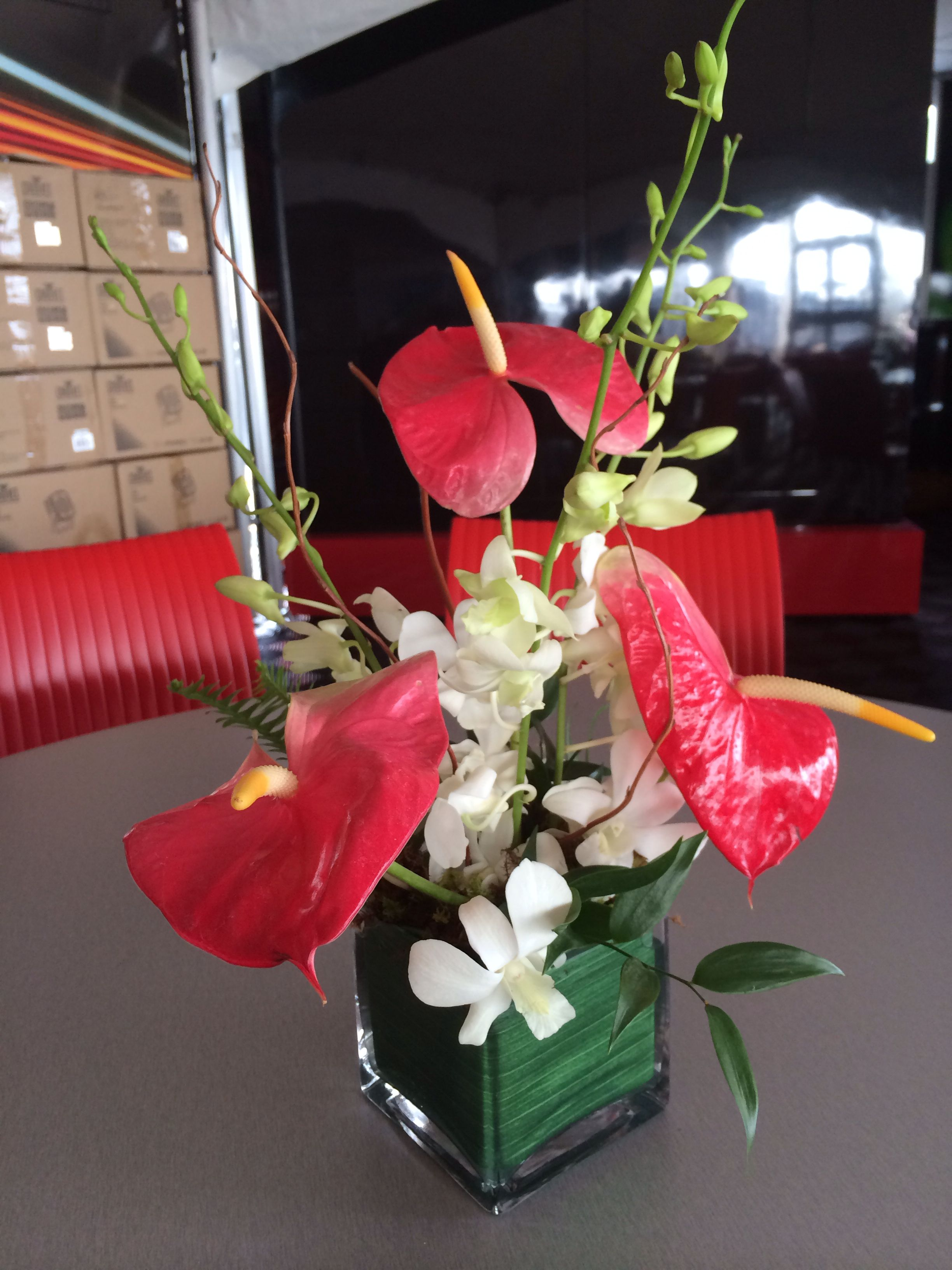 Tropical Centerpiece I Designed Using White Dendrobium Orchids And Red Anthuriums By Hobb Anthurium Arrangement Tropical Centerpieces White Dendrobium Orchids
