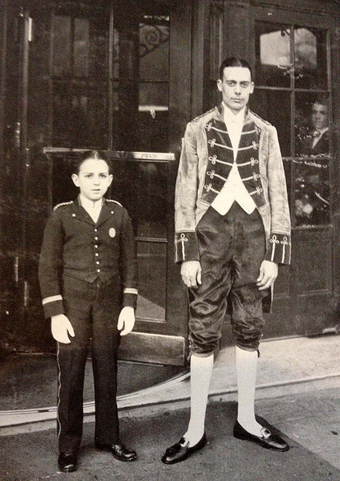 Footman and bellboy in front of the savoy hotel england for 1920s hotel decor