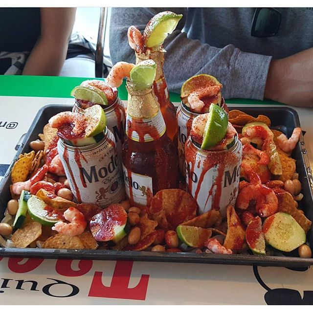 Beer,ships tostitos, camaron, pepino, cacahuate, limon, chile y chamoy.