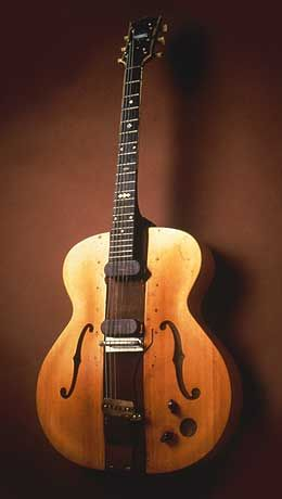 """""""The Log"""" - During the 1930s, inventive individuals experimented with guitar bodies made from a solid piece of wood rather than soundboards over a hollow chamber—partly for ease of fabrication, partly to prevent feedback.    One of the most prominent innovators was Les Paul. He made this guitar by taking a 4x4-inch solid block of pine, fitting it with two homemade electronic pickups, and then gluing on the halves of a hollow-body guitar to make it look slightly more conventional."""