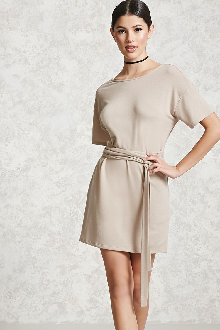 A soft french terry knit tshirt dress featuring a round neckline a