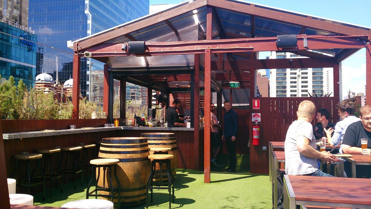 Rooftop Bar and Cinema is located at the top of Curtin House, Swanston Street, in the heart of Melbourne's CBD (between Little Bourke and Lonsdale Streets). Enter the lobby from Swanston Street, then take the lift (or brave the stairs) to level 6.