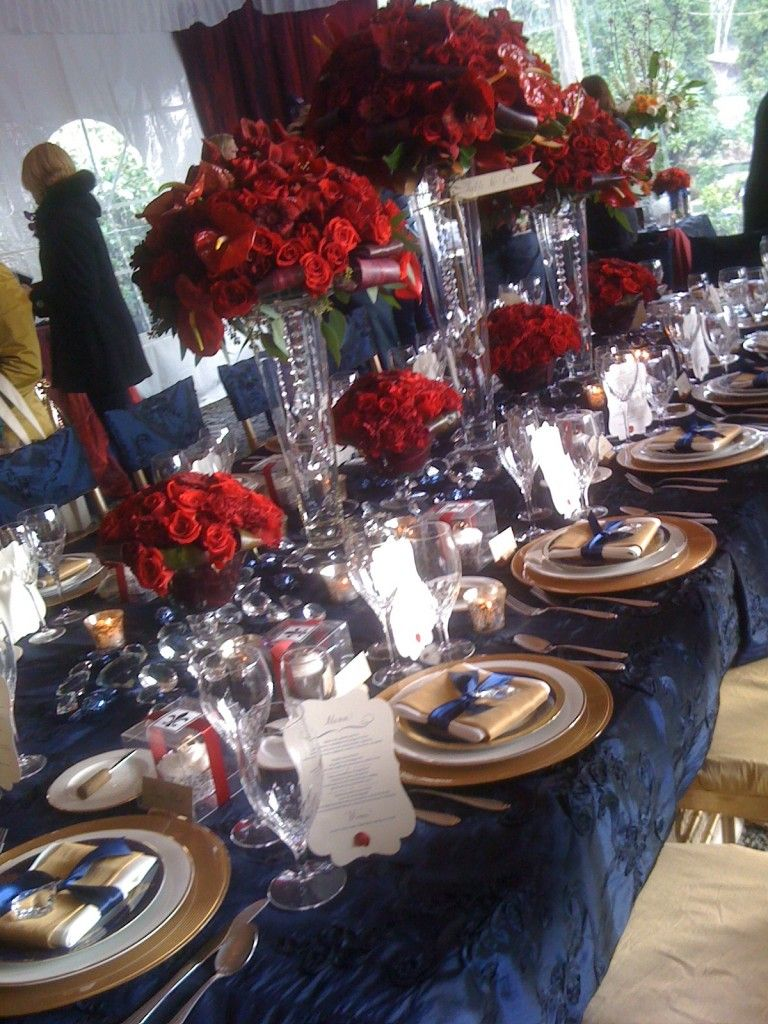 Too Much With The Navy Tablecloth, But Like The Gold Plates, Blue Accents,  And Some Sort Of Red Flower   Maybe More Poppy Than Pomegranante.