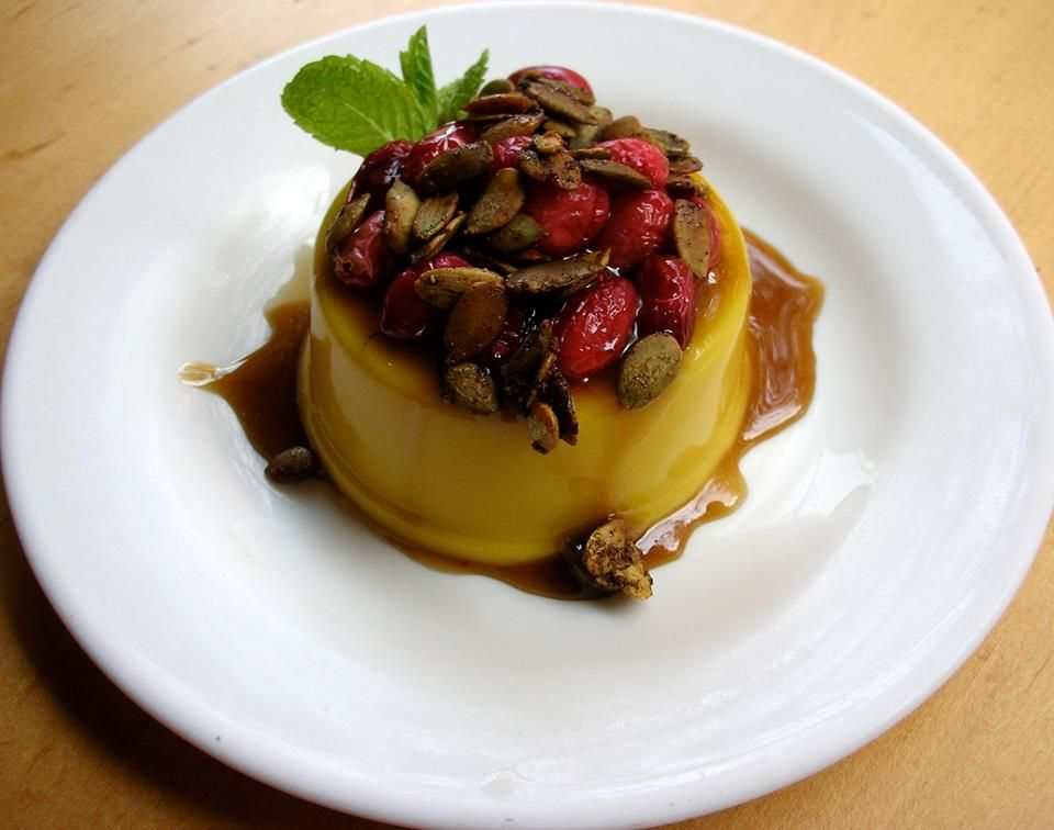 Angelica Kitchen Pumpkin Flan with caramel cranberries &  spiced pumpkin seeds  wedigfood.com will donate $1 every time you write a restaurant review to Root Capital, a nonprofit agricultural lender that grows rural prosperity in poor, environmentally vulnerable places.  #vegan