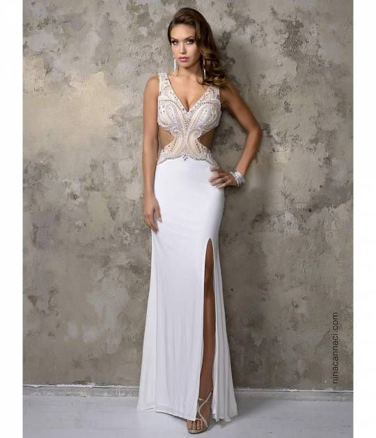 e26383f11f9 This sexy long dress has a fitted ivory skirt. The top is sparkling with  white and silver beads