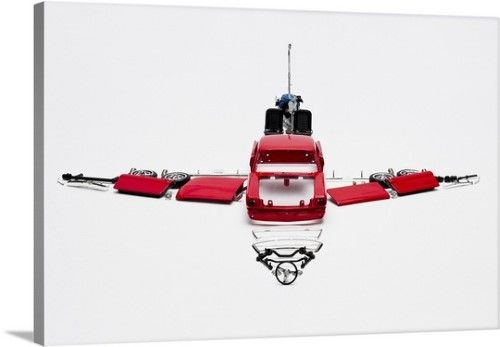 Premium Thick-Wrap Canvas Wall Art Print entitled Parts of a model car arranged in the form of an airplane, None