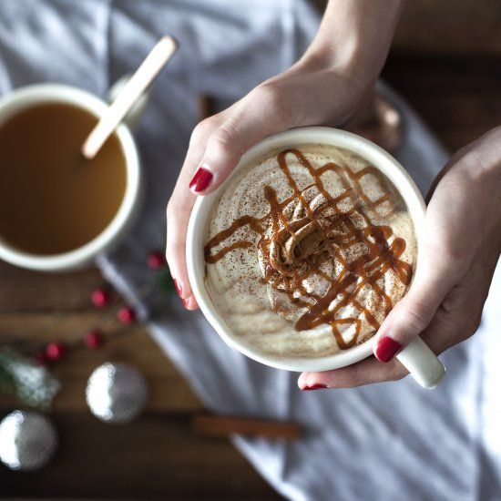 Salted caramel apple cider topped with whipped cream, cinnamon & more homemade salted caramel!