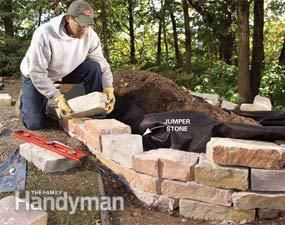build a raised garden bed from natural rough cut stone that blends perfectly into the
