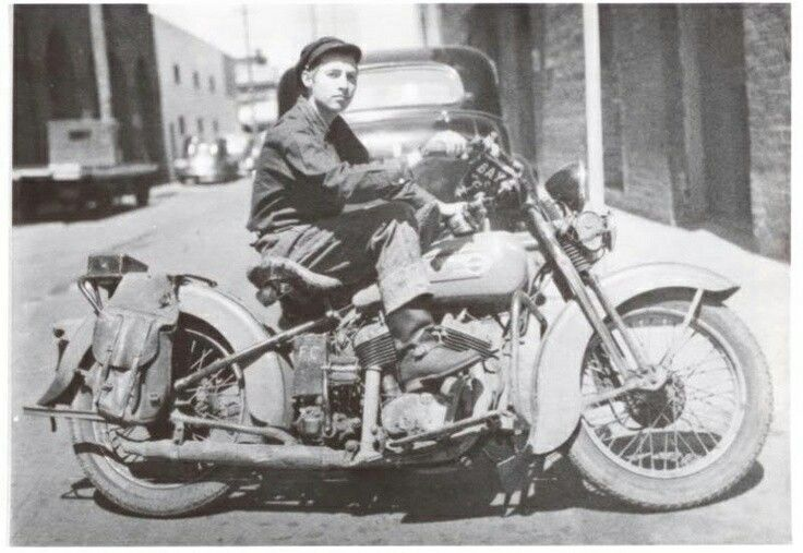 Young Bob Dylan on his motorcycle