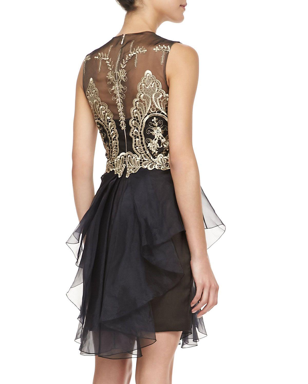Black cocktail dress with gold details