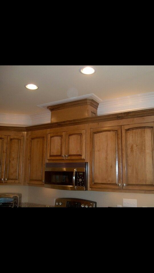 above microwave vent cover kitchen