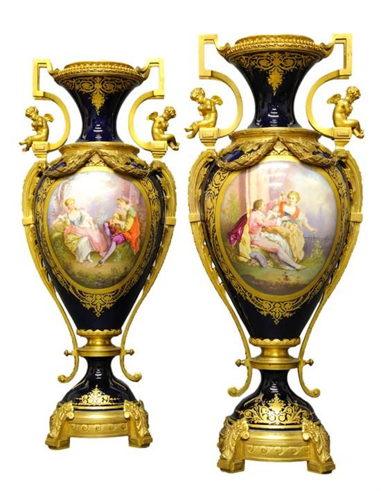 A Pair Of Antique Sevres Style Two Handled Vases With Bronze Mounts