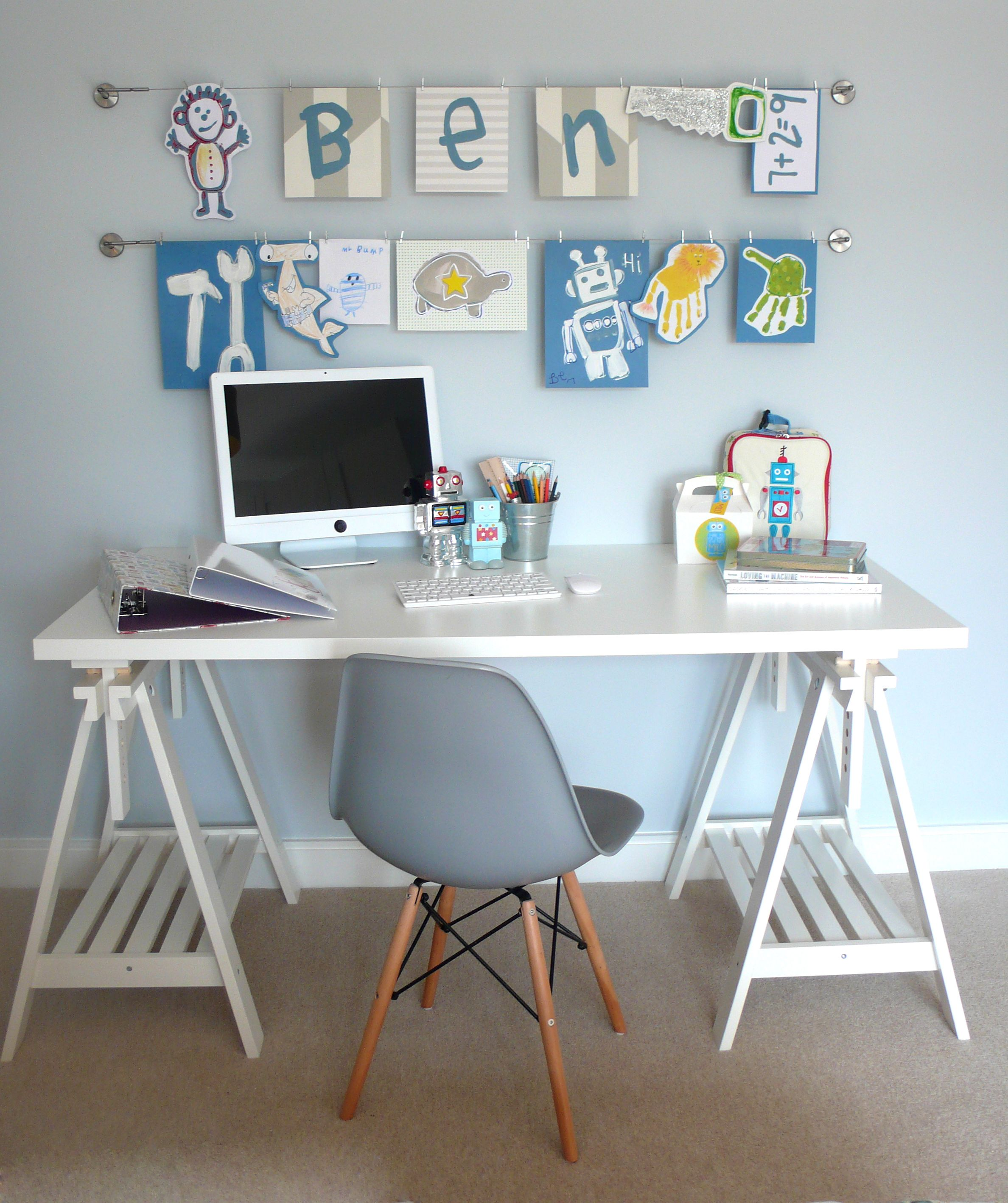 Kids artwork on wires over desk. Artspace Interior Design LTD