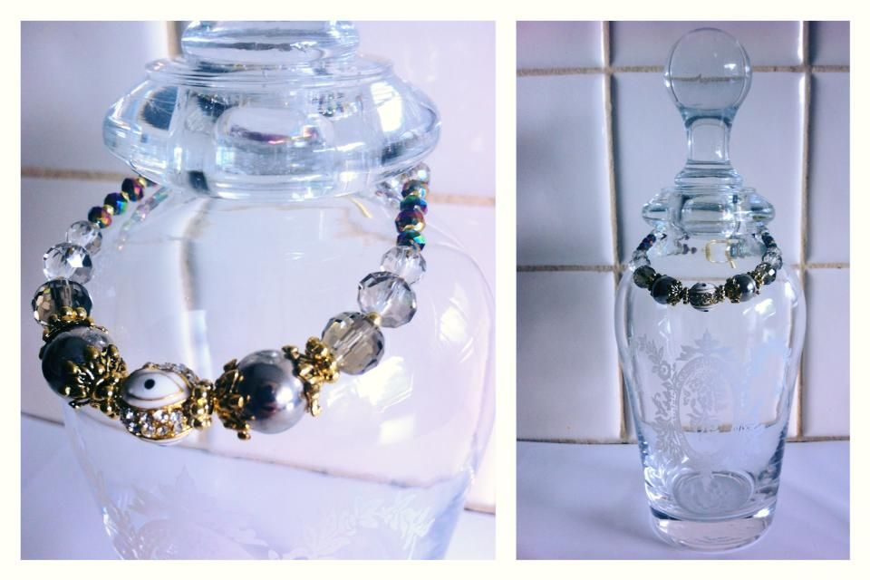 https://www.facebook.com/BleakDesigns  Bleak Bracelet   Crystal + Metal Look Beads + Evil Eye (Alloy + Enamel + Crystal) + OT Clasp.  $20.00