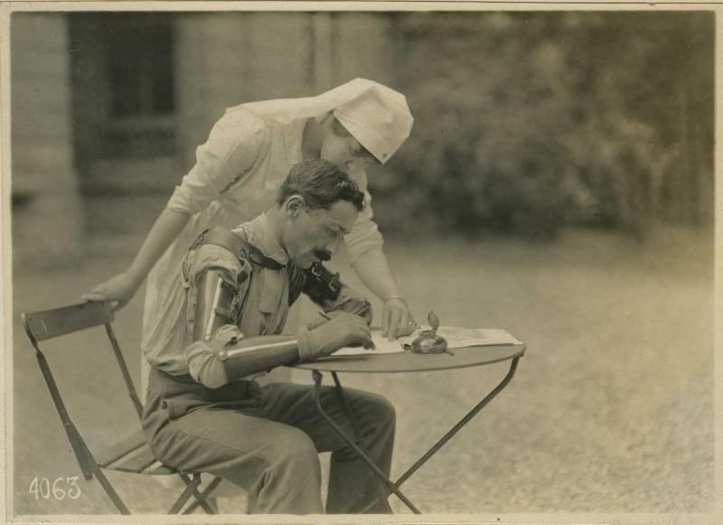 French Soldier with Dual Prosthetic Arms Learning to Write. (WW1)