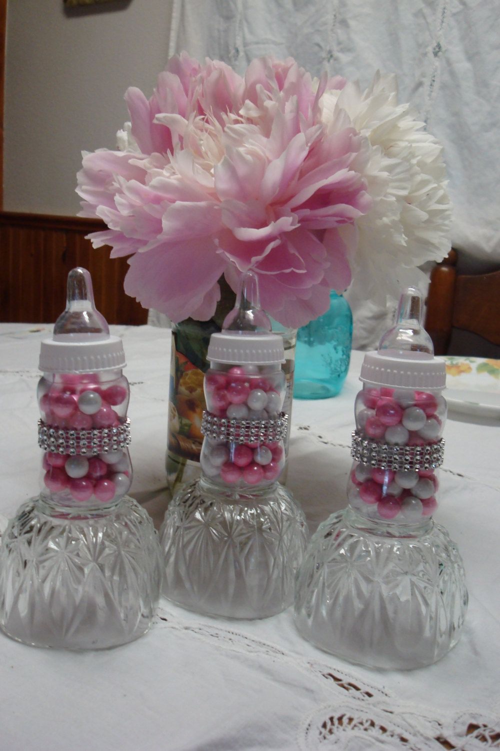 Princess themed baby shower favors tiffany themed baby for Baby bottle decoration ideas
