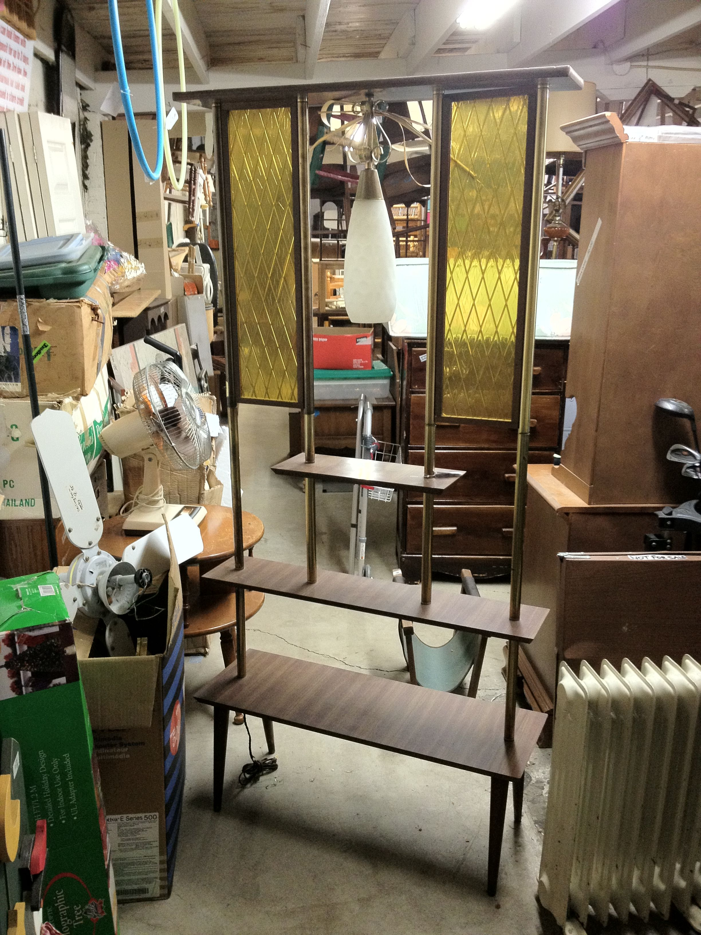 Mid century modern room divider hanging lamp in the middle lol