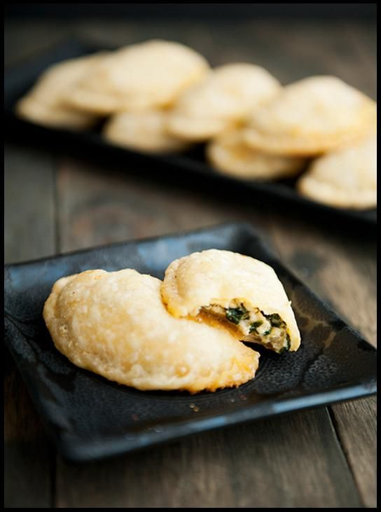 http://userealbutter.com/2012/07/03/spinach-cheese-empanadas-recipe/  - here's the link to the recipe.