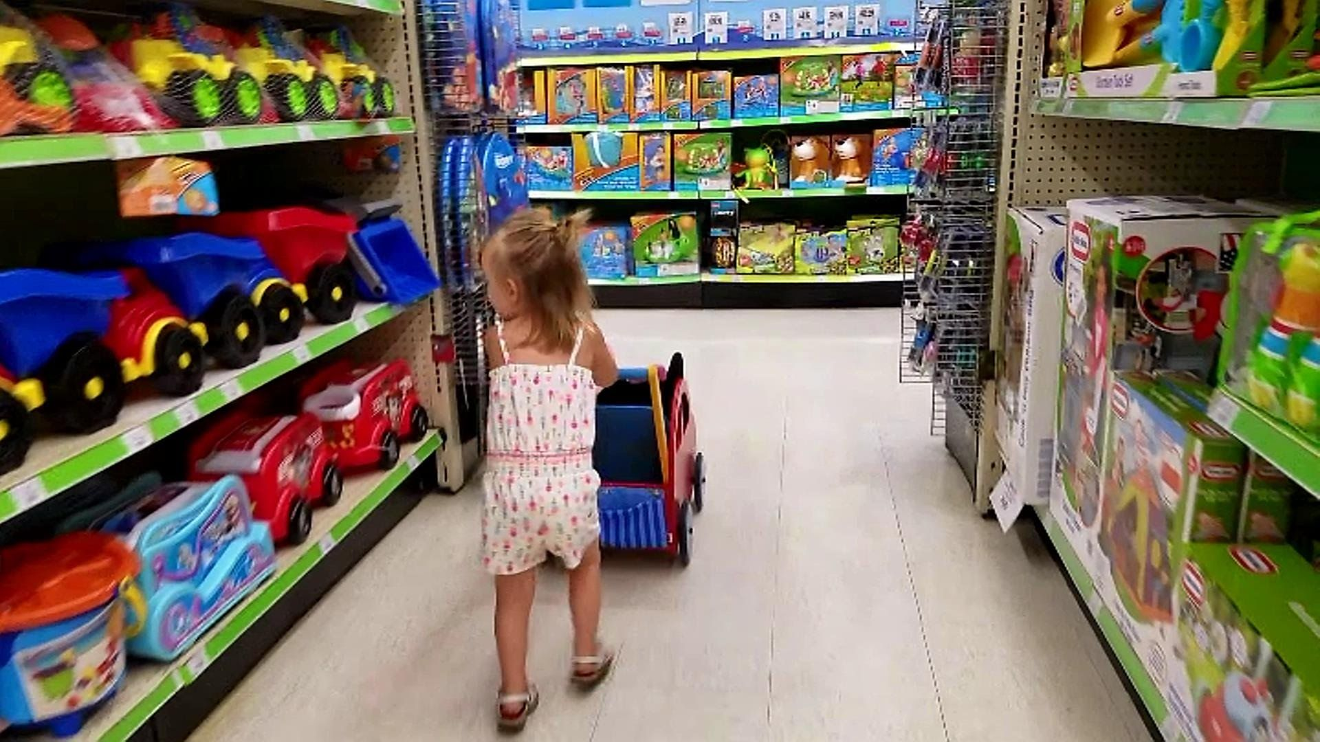 Cute Little Girl Toys R Us Shopping With Peppa Pig and Minnie