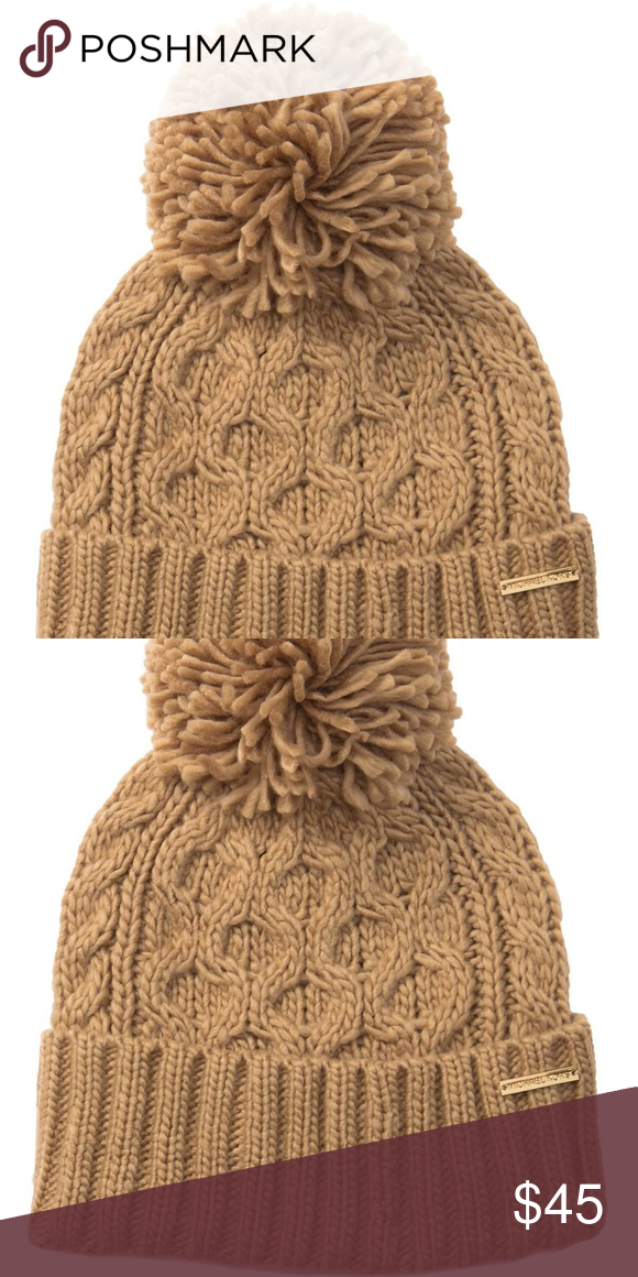 4c08fa203a26a Michael Kors Pompom Cable Knit Beanie Pompom detail - Cable knit  construction - Rib knit folded cuff - Logo hardware detail 100% acrylic  Color CAMEL Michael ...