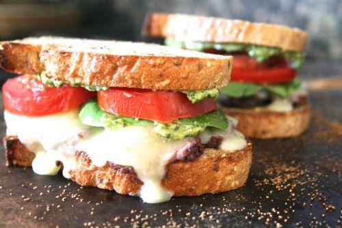 love at first bite. [beef tenderloin sandwich w. tomato, avocado, provolone & homemade pesto]
