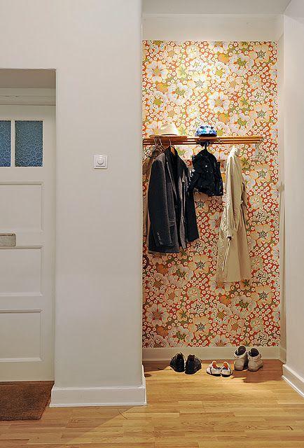 Remove closet doors to make a niche...wallpaper inside for p.