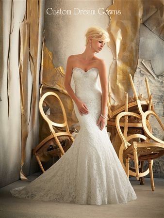Beautiful Embroidered Lace Mermaid Wedding Gown with Crystal Beaded Sweetheart Neckline, Fitted Bodice Past Hips into Flared Mermaid Skirt, Chapel Train, Embellished Backline with Covered Buttons Over Hidden Zipper Closure. #customweddingdress #customgown #mermaidweddingdress #beautifulweddingdress #sweetheart #crystalneckline #destinationwedding #beachwedding #chapel #sayyestothedress