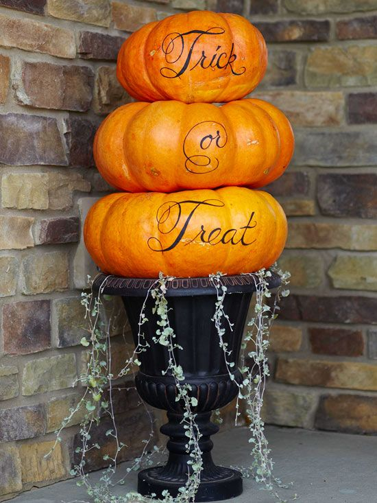 Greet trick-or-treaters with pretty painted pumpkins. Find out how to make them here: http://www.bhg.com/halloween/pumpkin-carving/cool-halloween-pumpkins/#page=5