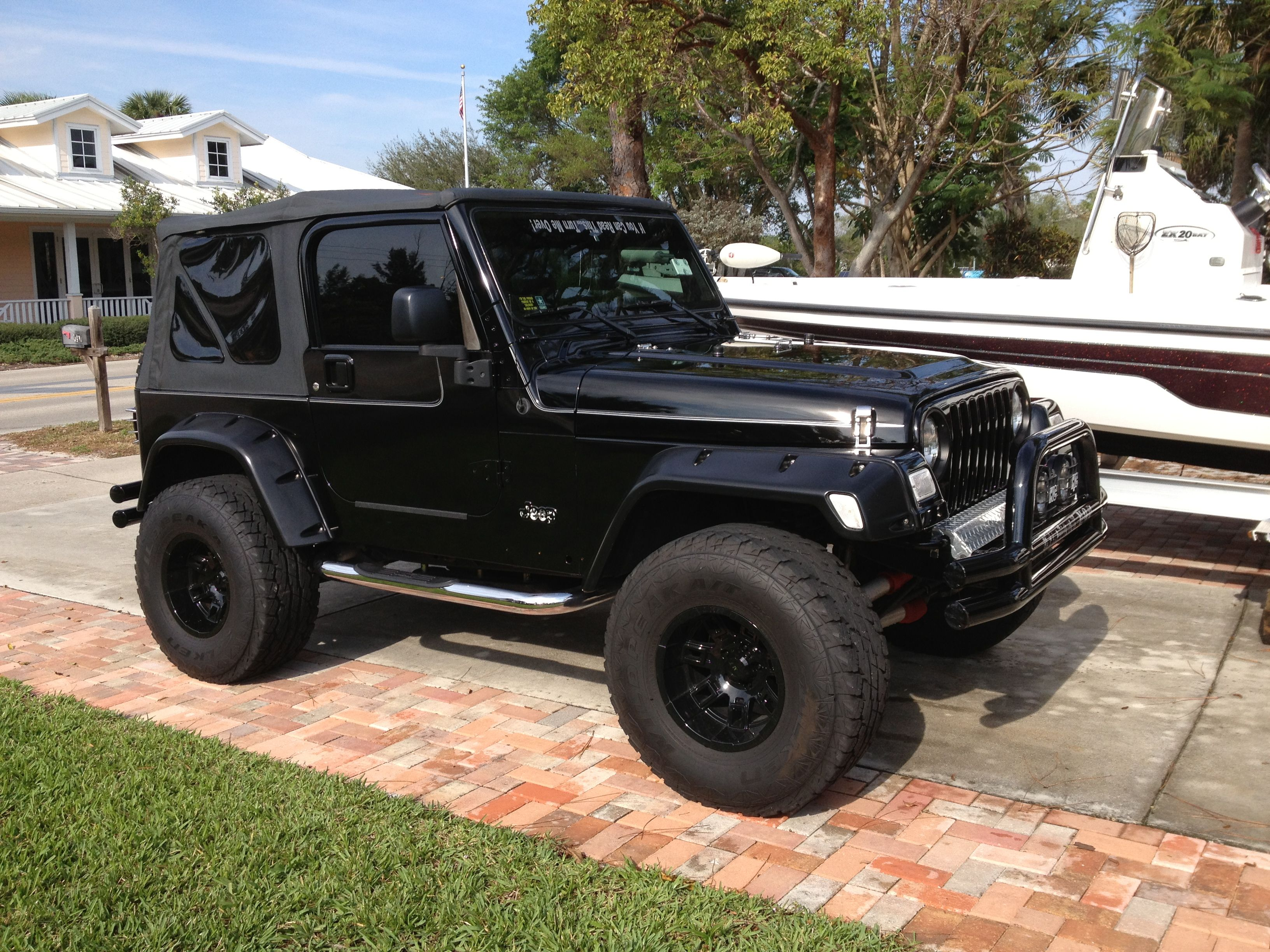 Completely Blacked Out Jeep Wrangler Shod in Off-Road ... |Murdered Out Jeep Wrangler