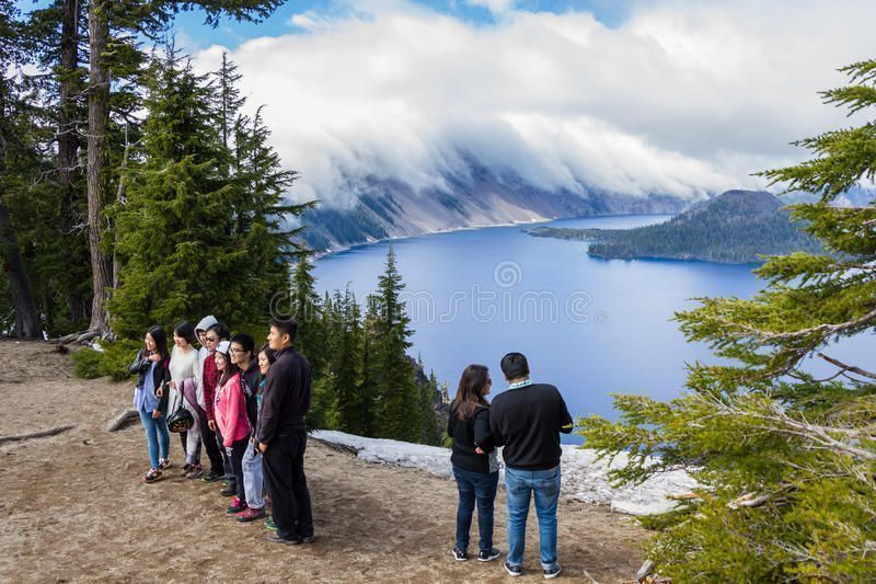 Tourists in Crater Lake Crater Lake Oregon  May 23  Tourist taking pictures  Tourists in Crater Lake Crater Lake Oregon  May 23  Tourist taking pictures  Tourists in Crat...