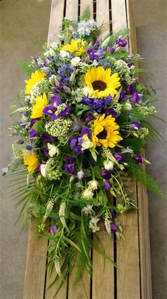 Gorgeous Sunflower And Purple Casket Spray Funeral Arrangement Funeral Flower Arrangements Casket Flowers Memorial Flowers