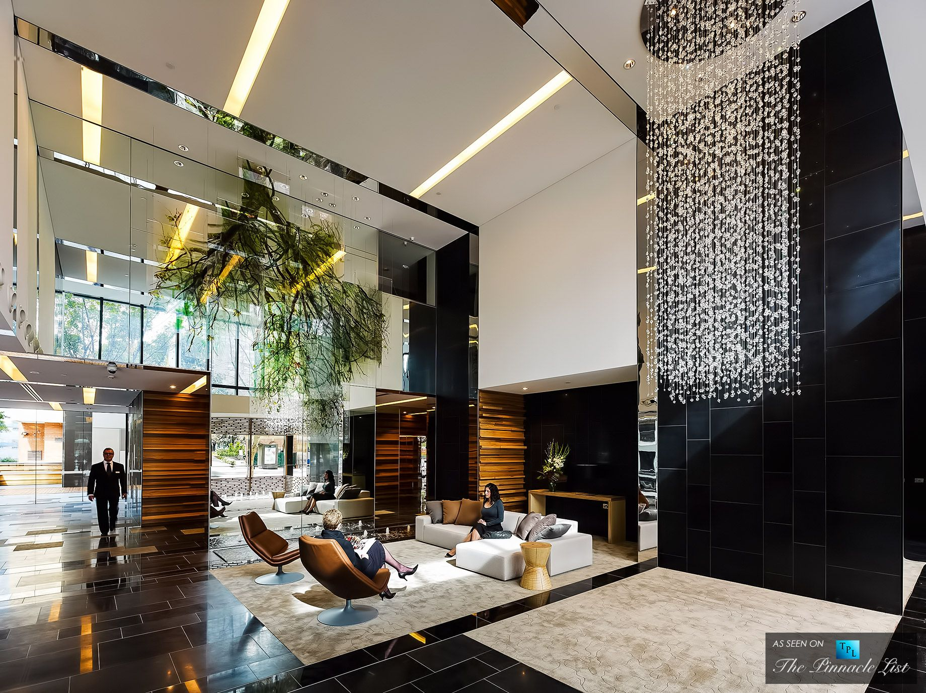 The sunlit double lobby of the luxury hyde apartment for Apartment design sydney