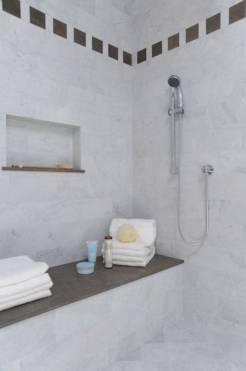 Gorgeous Master Shower Boasts Marble Clad Walls Dotted