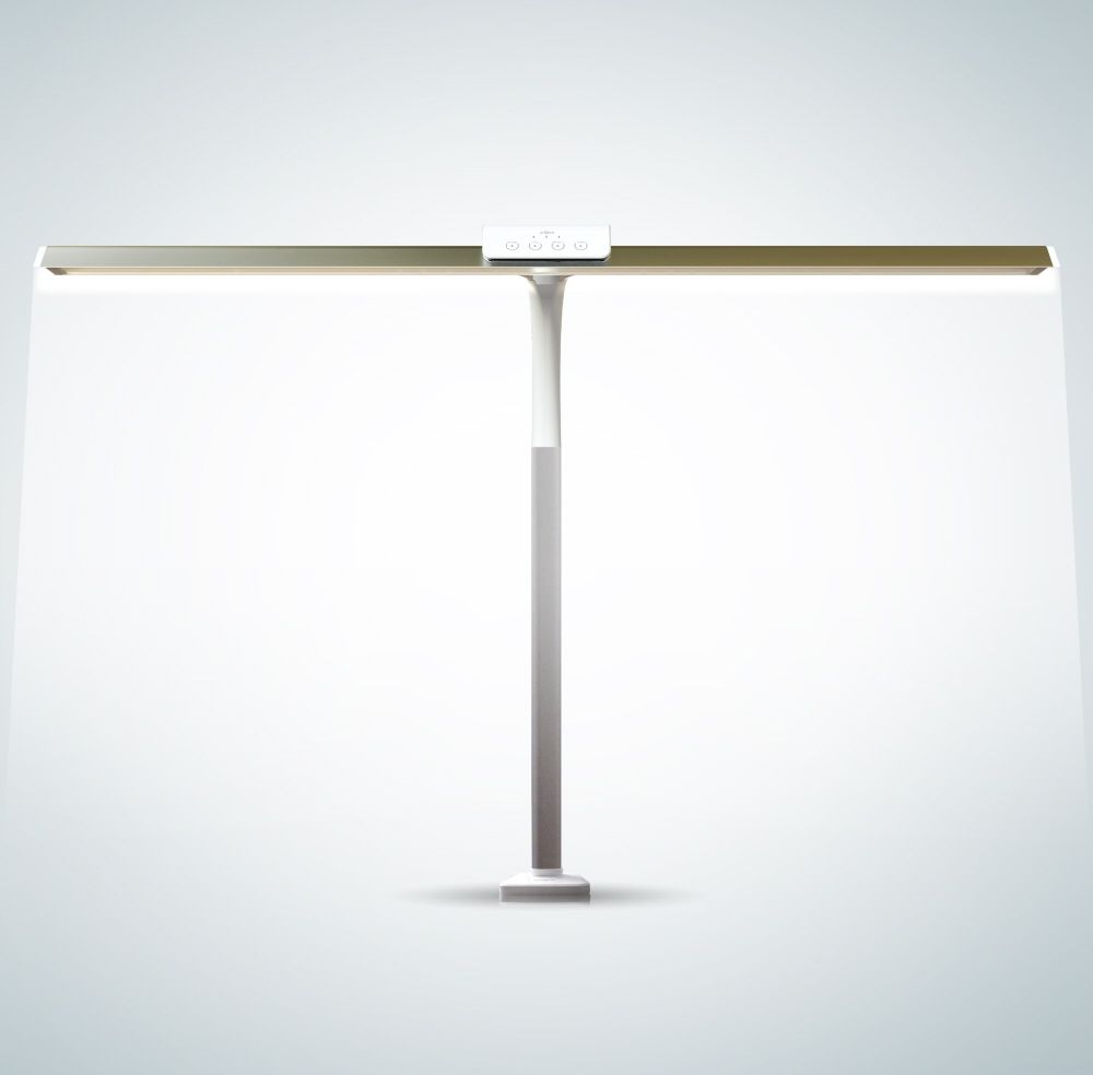 The Epikos is a revolutionary task light that allows you to control the color temperature and dimming level for your entire work area. It's flexible neck rises above your computer monitors and its wide beam allows you to shut off poor overhead lighting and customize your desk top.