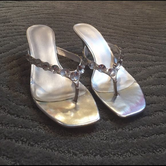 Nine West silver brushed leather dress sandals These silver 1 inch heel dress heels have only been worn 2-3 times and no longer fit me. They are in great condition and come with the original shoe box. Nine West Shoes Sandals