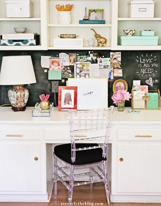 Chalkboard back, white desk and overhead shelves make for a great home office