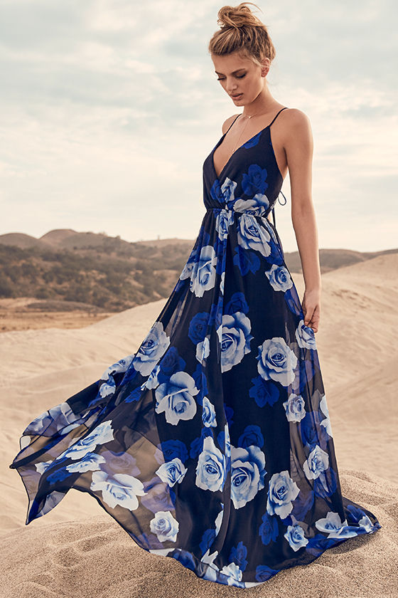 6955d7a79db You ll feel like you re floating on a cloud in the Only in Dreams Navy Blue Floral  Print Maxi Dress! Lovely navy blue chiffon in an allover rose print flows  ...