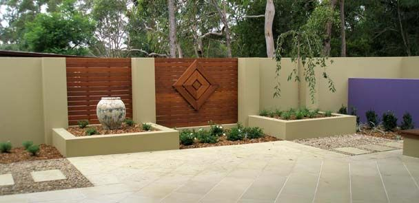 Timber feature wall courtyards pinterest raised for Outdoor feature wall ideas