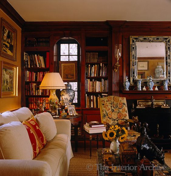 A Plump Sofa Covered In Cushions Lines One Wall Of This Library Style Living Room By John Rosselli Home English Decor Interior