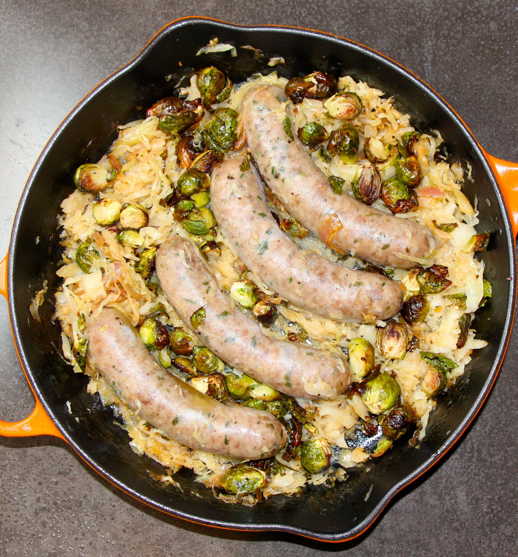 Beer braised bratwurst carmelized sauerkraut and