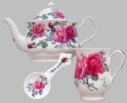 Our English Rose Teapot Set includes one 3 Cup(20 ounce) teapot, 2 mugs, and 2 spoon rests, all featuring a bold rose pattern on a white bone china background.  What a lovely way to share tea with a friend!  The set in made by Heirloom china and imported from England.
