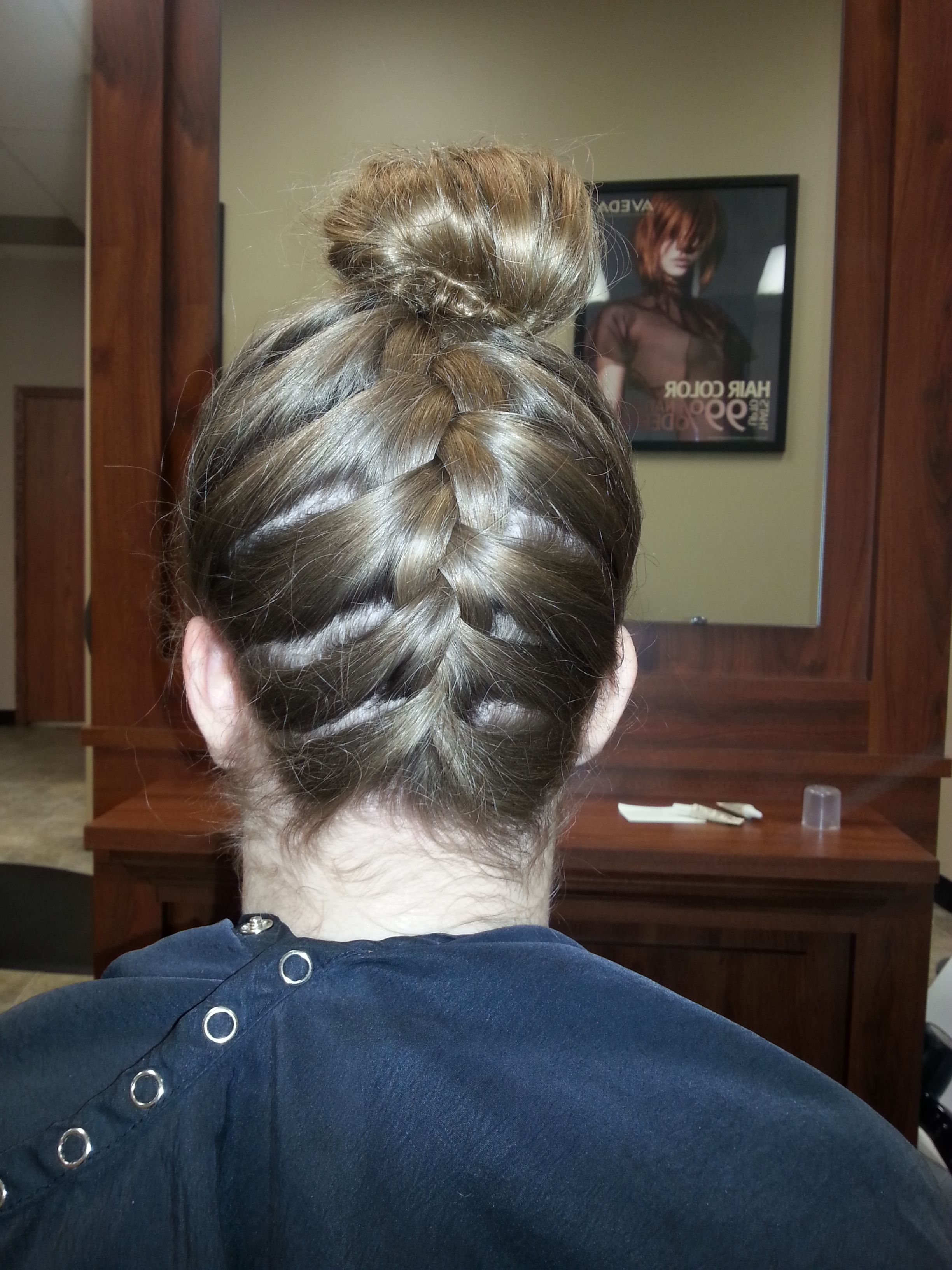 French braid into a tight top bun. View 1/3.