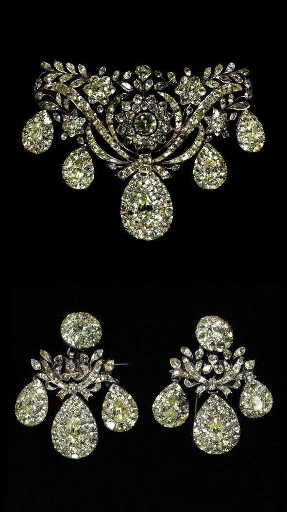Bodice ornament and earrings, chrysoberyls set in silver, with stylised flowers and leaves, made in Portugal, about 1760. [Bodice ornament] Height: 77 mm, Width: 108 mm, Depth: 20 mm [Earring] Height: 61 mm, Width: 53 mm, Depth: 13 mm