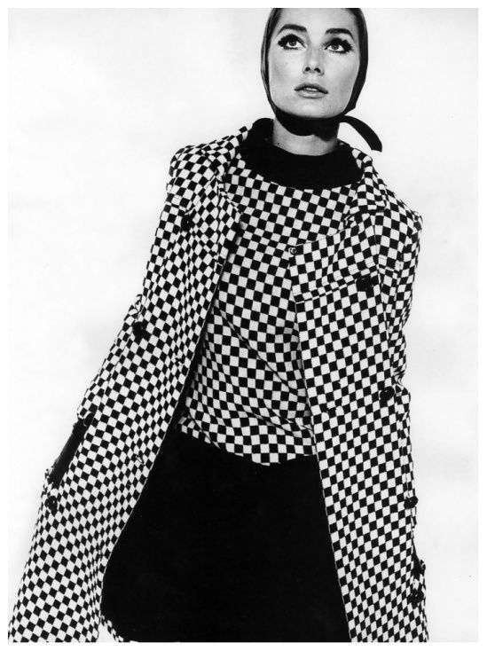Tania Mallett in a black-and-white checked coat and sleeveless dress by Polly Peck. Photo: John French, 1963.