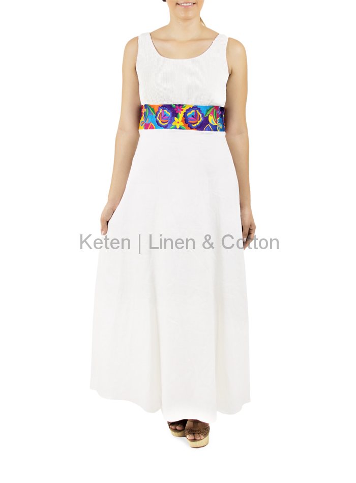 Long dress that which designed in White Linen, with a colorful embroidery  on the waist, to get the center of attention. Being a simple garment and  with only ...