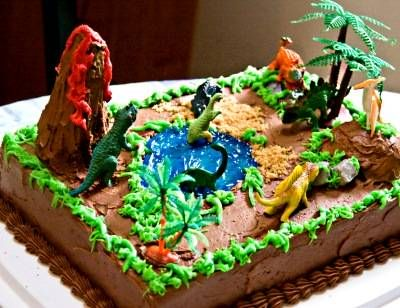 Dinosaur cake ideas for kids birthday parties.  See decorating tips and how to's.